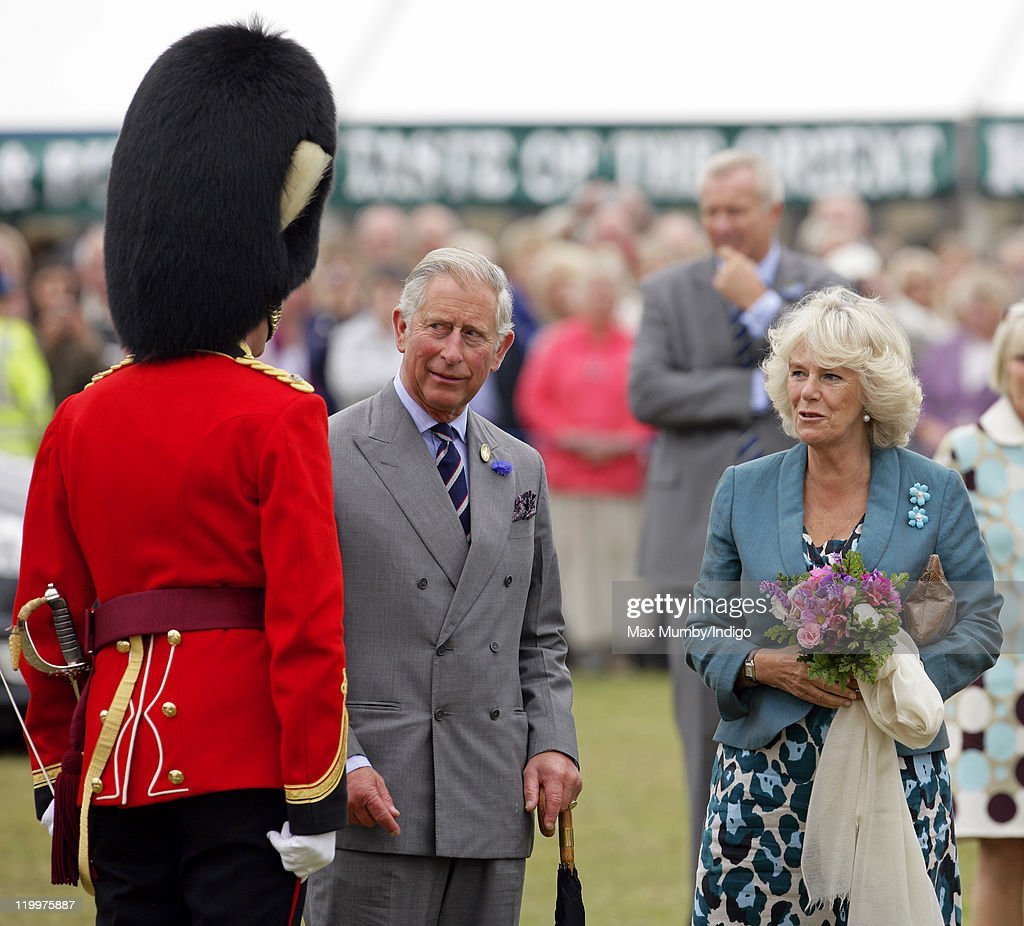 <a gi-track='captionPersonalityLinkClicked' href=/galleries/search?phrase=Prince+Charles&family=editorial&specificpeople=160180 ng-click='$event.stopPropagation()'>Prince Charles</a>, Prince of Wales and Camilla, Duchess of Cornwall talk with the conductor of the military band as they visit the 130th Sandringham Flower Show on July 27, 2011 in Huntingdon, England.