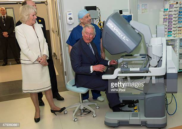 Prince Charles Prince of Wales and Camilla Duchess of Cornwall test new medical equipment as they officially open the new Chelsea and Westminster...
