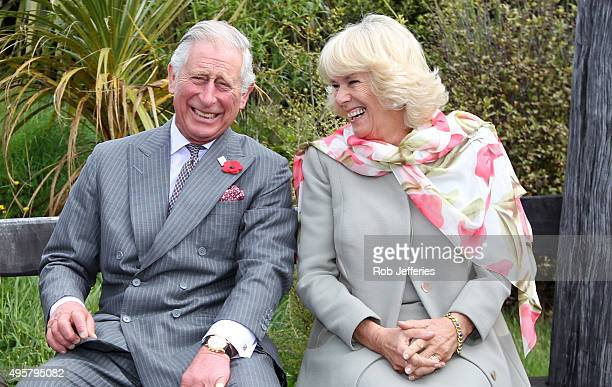 Prince Charles Prince of Wales and Camilla Duchess of Cornwall continue to laugh after a bubble bee took a liking to Prince Charles during their...