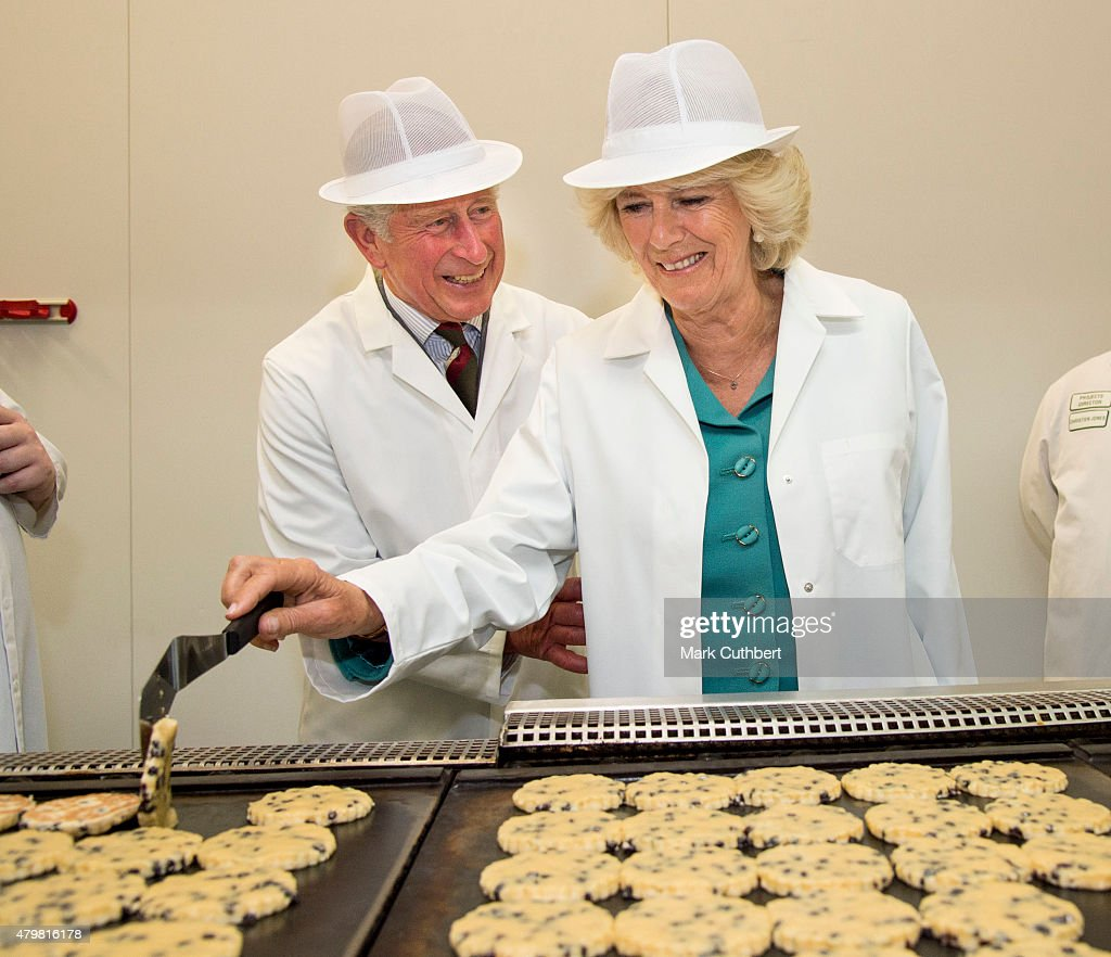 Prince Charles Prince of Wales and Camilla Duchess of Cornwall tour the Village Bakery on July 7 2015 in Wrexham Wales
