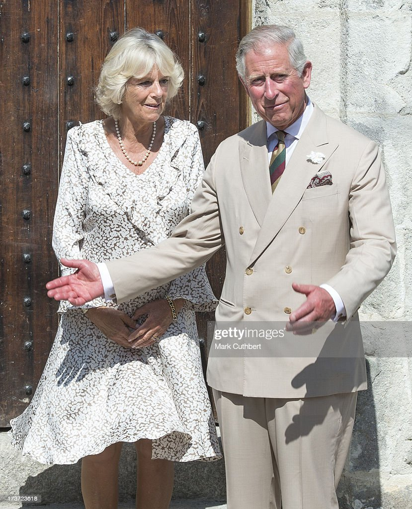 Prince Charles, Prince of Wales and <a gi-track='captionPersonalityLinkClicked' href=/galleries/search?phrase=Camilla+-+Hertiginna+av+Cornwall&family=editorial&specificpeople=158157 ng-click='$event.stopPropagation()'>Camilla</a>, Duchess of Cornwall, unveil a plaque to mark the restoration of The Duchy Palace, on a visit to Lostwithiel on July 17, 2013 in Cornwall, England.