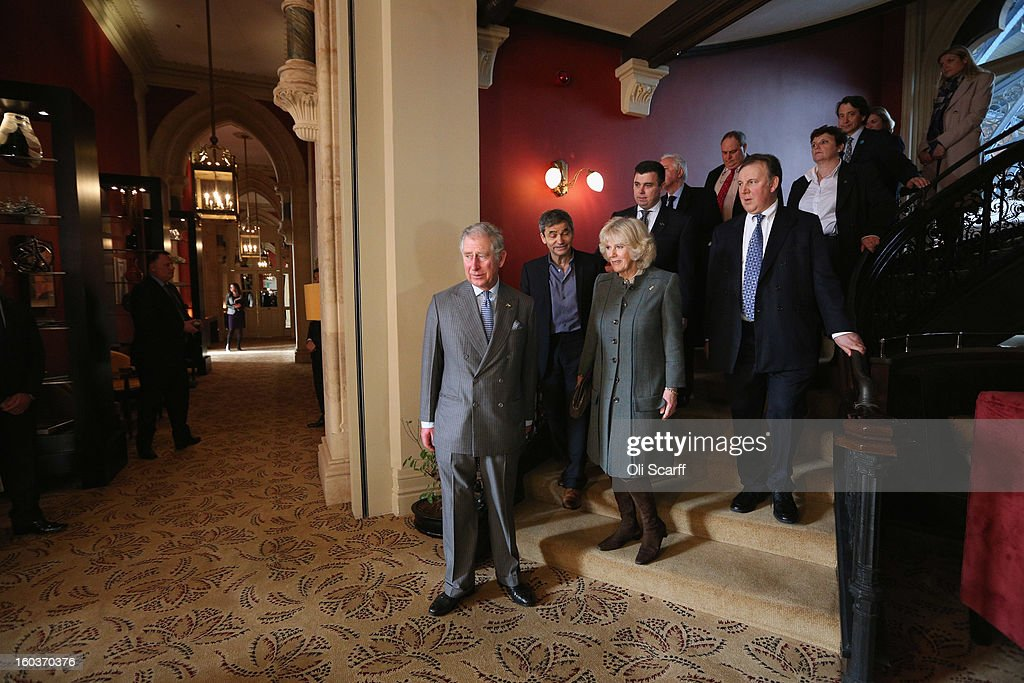 Prince Charles, Prince of Wales (L) and Camilla, Duchess of Cornwall (2nd L) vare accompanied by General Manager Kevin Kelly and co-owners Harry Handelsman and Lord Stanley Fink during a visit to the recently regenerated St Pancras Renaissance London Hotel adjacent to St Pancras International Station on January 30, 2013 in London, England. The Prince of Wales and The Duchess of Cornwall are marking the 150th anniversary of London Underground to emphasise the importance of engineering and infrastructure development in the UK.