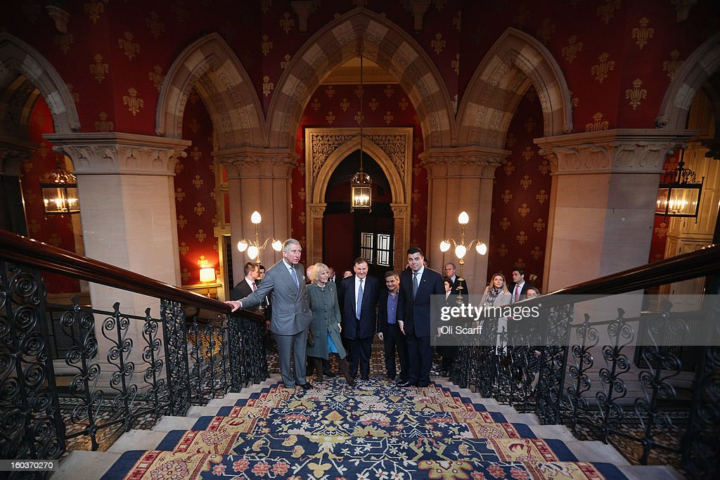 Prince Charles, Prince of Wales (L) and Camilla, Duchess of Cornwall (2nd L) view the grand staircase with General Manager Kevin Kelly (R) and Co-owners Harry Handelsman (2nd R) and Lord Stanley Fink (C) during a visit to the recently regenerated St Pancras Renaissance London Hotel adjacent to St Pancras International Station on January 30, 2013 in London, England. The Prince of Wales and The Duchess of Cornwall are marking the 150th anniversary of London Underground to emphasise the importance of engineering and infrastructure development in the UK.