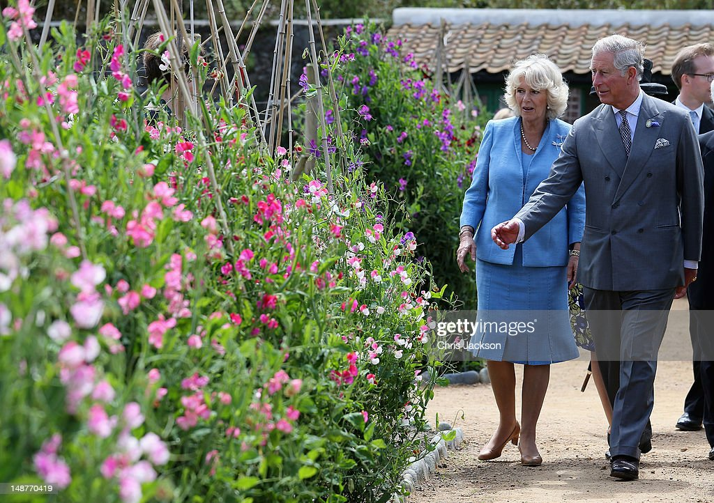 <a gi-track='captionPersonalityLinkClicked' href=/galleries/search?phrase=Prince+Charles&family=editorial&specificpeople=160180 ng-click='$event.stopPropagation()'>Prince Charles</a>, Prince of Wales and <a gi-track='captionPersonalityLinkClicked' href=/galleries/search?phrase=Camilla+-+Duchess+of+Cornwall&family=editorial&specificpeople=158157 ng-click='$event.stopPropagation()'>Camilla</a>, Duchess of Cornwall visit Saumarez Park on July 19, 2012 in St Peter's Port, United Kingdom. The Prince of Wales and the Duchess of Cornwall are in Guernsey as part of a Diamond Jubilee visit to the Channel Islands taking in Jersey, Guernsey and Sark