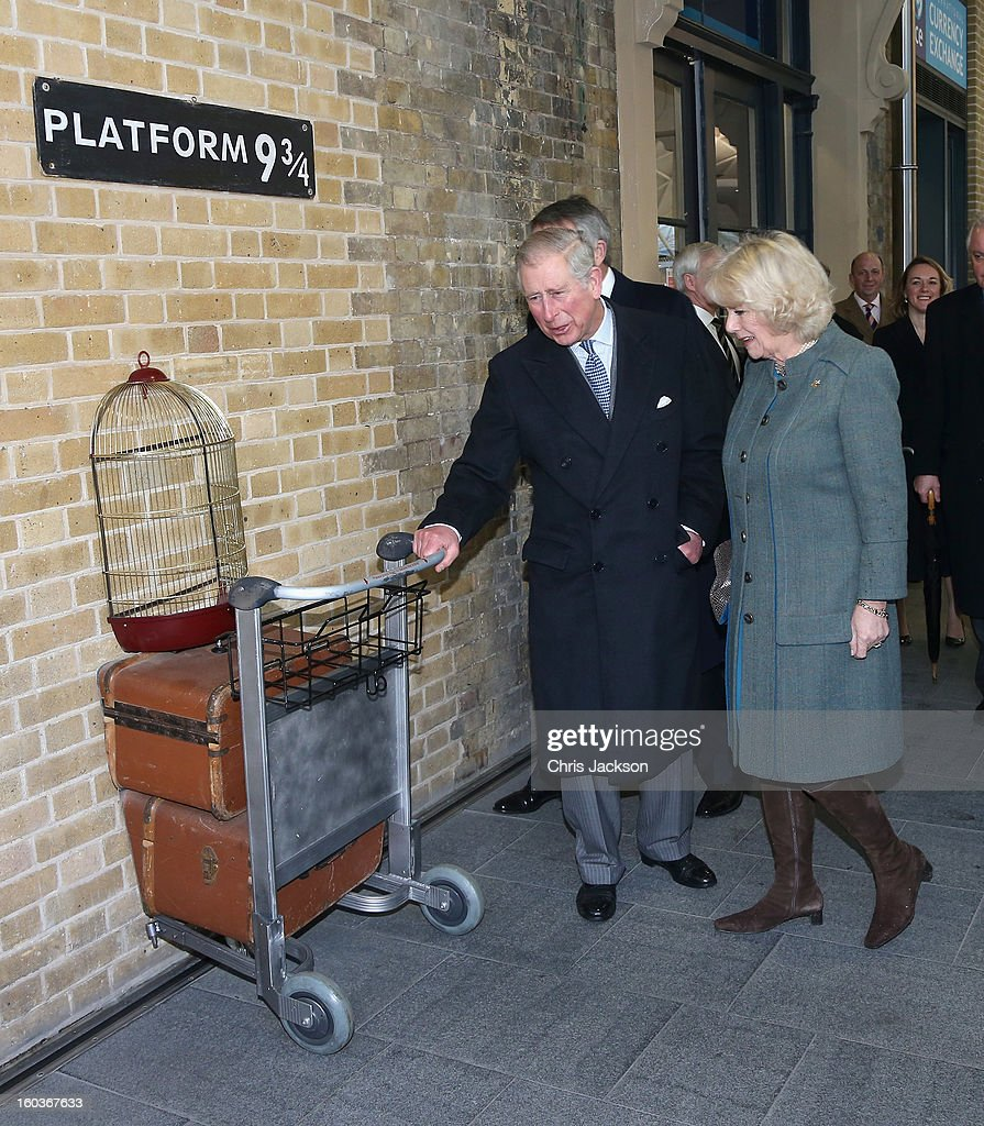 Prince Charles, Prince of Wales and <a gi-track='captionPersonalityLinkClicked' href=/galleries/search?phrase=Camilla+-+Duchessa+di+Cornovaglia&family=editorial&specificpeople=158157 ng-click='$event.stopPropagation()'>Camilla</a>, Duchess of Cornwall visit platform 9 3/4 at King's Cross Rail Station during a visit to mark 150 years of London Underground on January 30, 2013 in London, England.