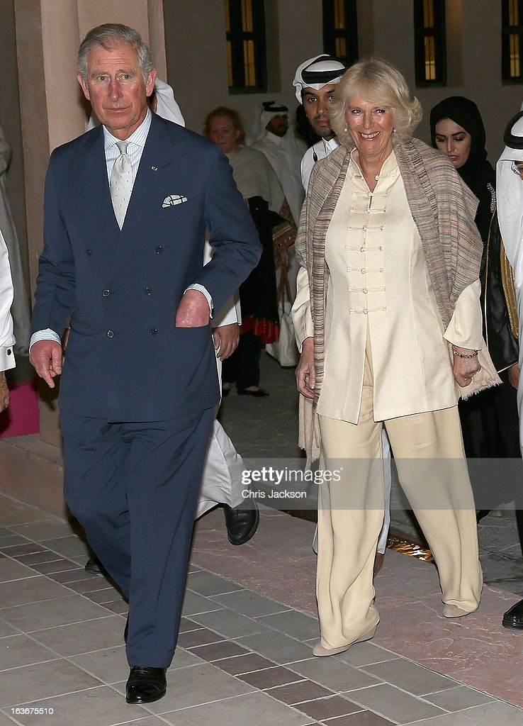<a gi-track='captionPersonalityLinkClicked' href=/galleries/search?phrase=Prince+Charles+-+Prince+of+Wales&family=editorial&specificpeople=160180 ng-click='$event.stopPropagation()'>Prince Charles</a>, Prince of Wales and <a gi-track='captionPersonalityLinkClicked' href=/galleries/search?phrase=Camilla+-+Duchess+of+Cornwall&family=editorial&specificpeople=158157 ng-click='$event.stopPropagation()'>Camilla</a>, Duchess of Cornwall visit the Katara Cultural Village on the fourth day of a tour of the Middle East on March 14, 2013 in Doha, Qatar. The Royal couple are on the second leg of a tour of the Middle East taking in Qatar, Saudia Arabia and Oman.