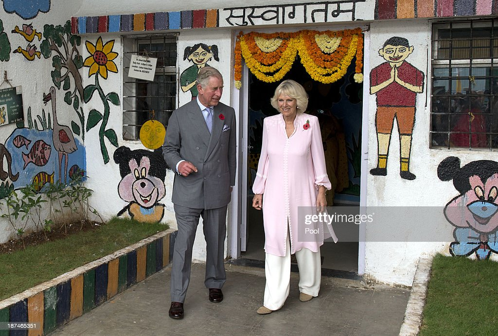 <a gi-track='captionPersonalityLinkClicked' href=/galleries/search?phrase=Prince+Charles+-+Prince+of+Wales&family=editorial&specificpeople=160180 ng-click='$event.stopPropagation()'>Prince Charles</a>, Prince of Wales and <a gi-track='captionPersonalityLinkClicked' href=/galleries/search?phrase=Camilla+-+Duchess+of+Cornwall&family=editorial&specificpeople=158157 ng-click='$event.stopPropagation()'>Camilla</a>, Duchess of Cornwall visit a Mumbai mobile creche during day 4 of an official visit to India on November 9, 2013 in Mumbai, India. This will be the Royal couple's third official visit to India together and their most extensive yet, which will see them spending nine days in India and afterwards visiting Sri Lanka in order to attend the 2013 Commonwealth Heads of Government Meeting.