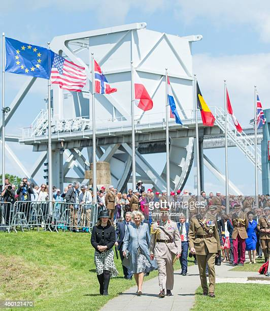 Prince Charles Prince of Wales and Camilla Duchess of Cornwall visit Pegasus Bridge during DDay Commemorations on June 5 2014 in Ranville France