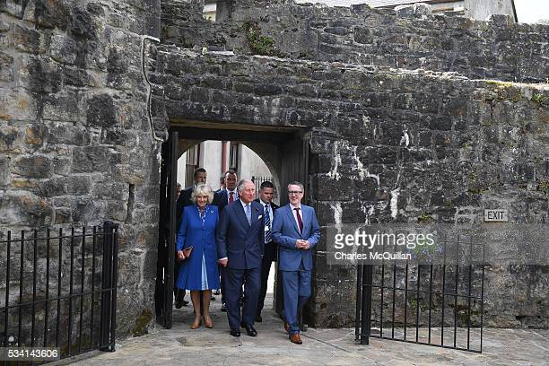 Prince Charles Prince of Wales and Camilla Duchess of Cornwall visit Donegal Castle guided by castle manager Sean McLoone on May 25 2016 in...
