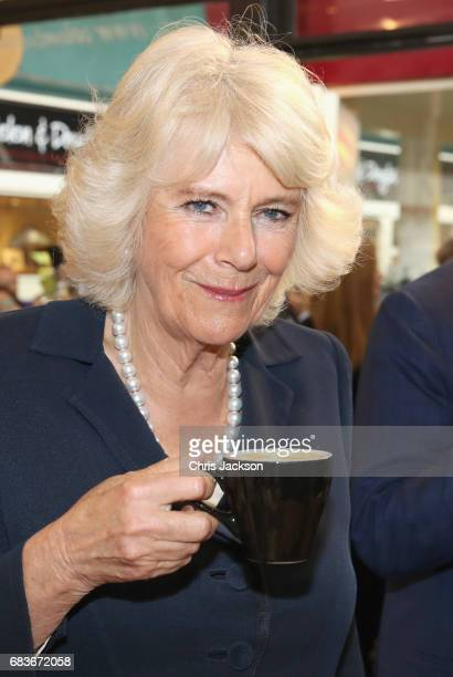 Prince Charles Prince of Wales and Camilla Duchess of Cornwall visit the historic Covered Market to sample produce and meet independent vendors at...