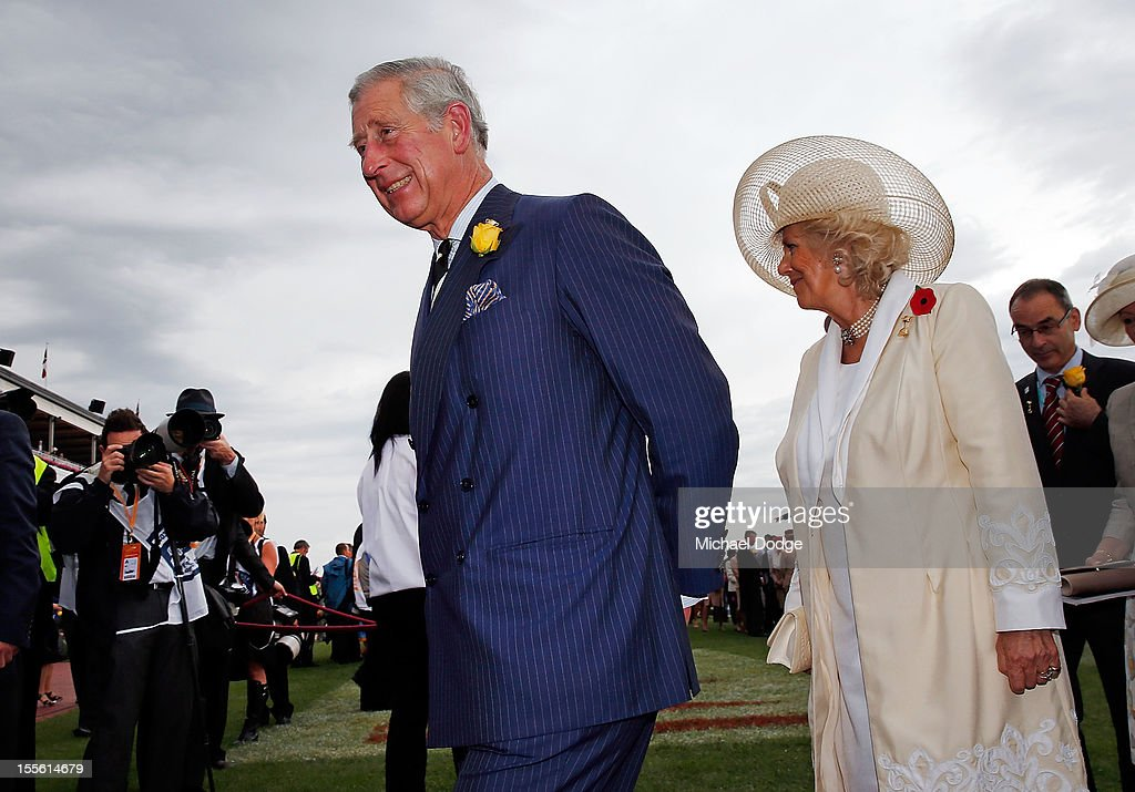Prince Charles, Prince of Wales and <a gi-track='captionPersonalityLinkClicked' href=/galleries/search?phrase=Camilla+-+Hertogin+van+Cornwall&family=editorial&specificpeople=158157 ng-click='$event.stopPropagation()'>Camilla</a>, Duchess of Cornwall walk through the mounting yard during the 2012 Melbourne Cup Day at Flemington Racecourse on November 6, 2012 in Melbourne, Australia.