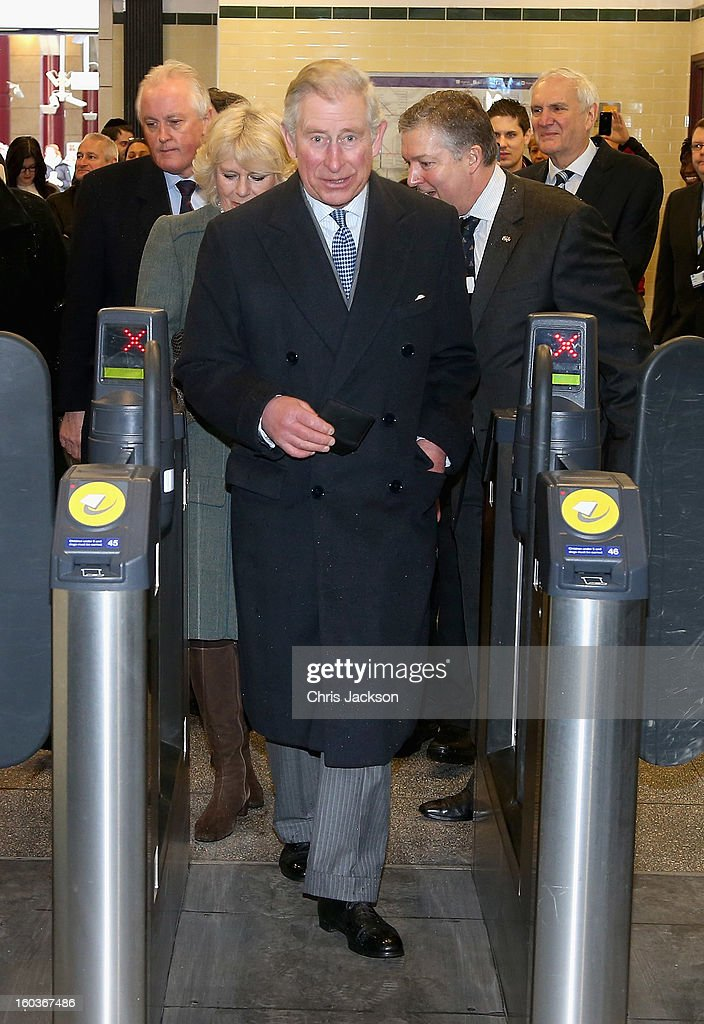 Prince Charles, Prince of Wales and Camilla, Duchess of Cornwall walk through a ticket gate as they prepare to travel on a Metropolitan underground train from Farringdon to King's Cross as they mark 150 years of London Underground on January 30, 2013 in London, England.