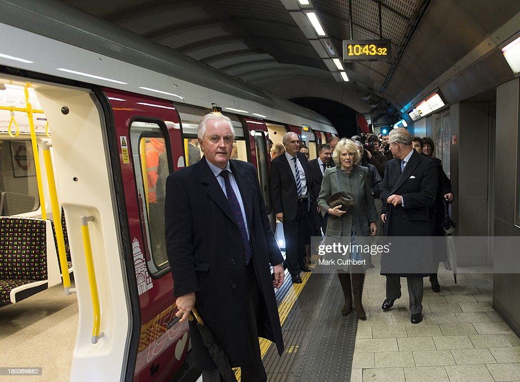 Prince Charles, Prince of Wales and Camilla, Duchess of Cornwall walk along an underground platform after getting off a London Tube train at King's Cross Station after viewing the Cross Rail developement site at Farringdon Station on January 30, 2013 in London, England.