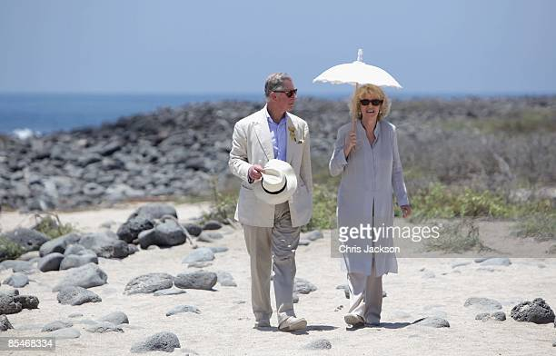 Prince Charles Prince of Wales and Camilla Duchess of Cornwall walk along the beach on North Seymour Island on the second day of a tour of the...