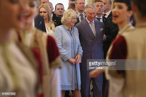 Prince Charles Prince of Wales and Camilla Duchess of Cornwall watch a Montenegran folk dance ensemble perform at a cultural heritage event on March...