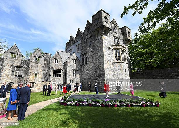 Prince Charles Prince of Wales and Camilla Duchess of Cornwall watch an Irish dancing performance as they visit Donegal Castle on May 25 2016 in...