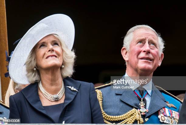 Prince Charles Prince of Wales and Camilla Duchess of Cornwall watch a flypast after a Service to mark the 77th anniversary of The Battle Of Britain...