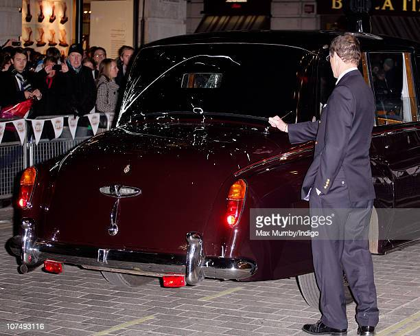 Prince Charles Prince of Wales and Camilla Duchess of Cornwall's chauffeur attempts to mend the arial on the Rolls Royce car which was attacked by...
