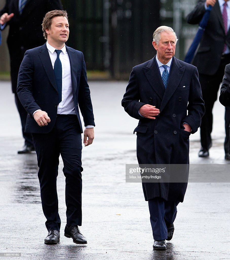 Prince Charles, Prince of Wales and chef <a gi-track='captionPersonalityLinkClicked' href=/galleries/search?phrase=Jamie+Oliver&family=editorial&specificpeople=159384 ng-click='$event.stopPropagation()'>Jamie Oliver</a> (L) visit Carshalton Boys Sports College to see how the school has transformed its approach to healthy eating on November 26, 2012 in Carshalton, England.
