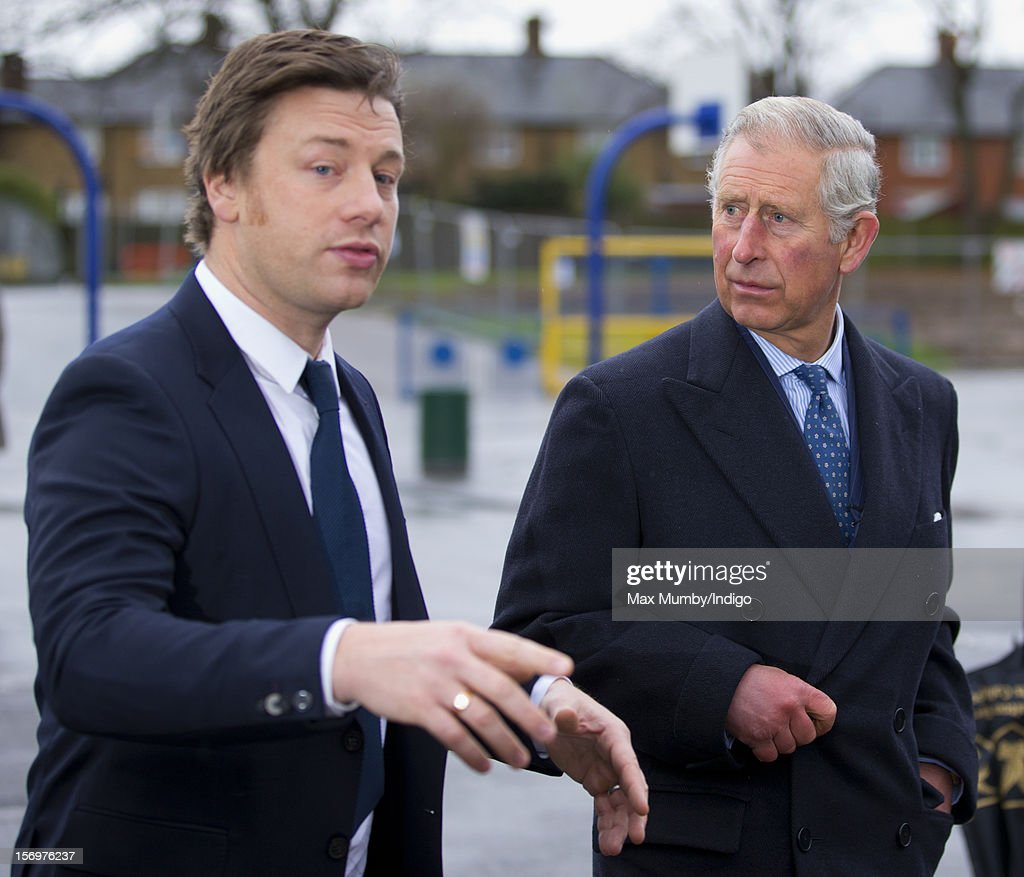 Prince Charles, Prince of Wales and chef Jamie Oliver (L) visit Carshalton Boys Sports College to see how the school has transformed its approach to healthy eating on November 26, 2012 in Carshalton, England.