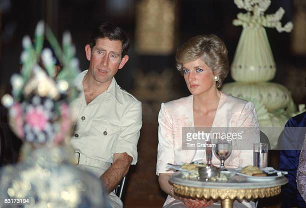 Prince Charles Prince of Wales and Diana Princess of Wales watch traditional dancing at the Palace of Yogyakarta during a royal tour of Indonesia on...