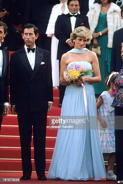 Princess Diana Princess of Wales wearing a pale blue chiffon dress and matching stole by Catherine Walker and Prince Charles Prince of Wales attend...