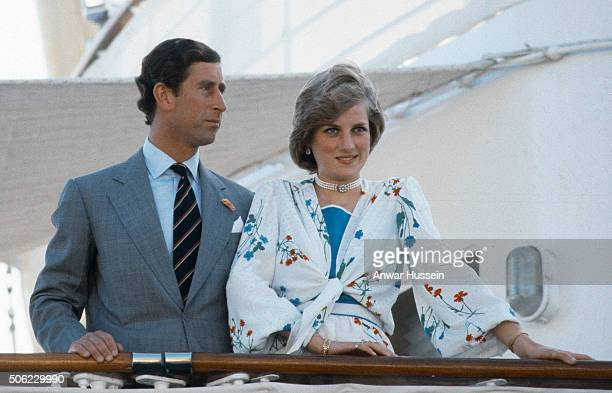 Diana Princess of Wales and Prince Charles Prince of Wales stand on the deck of the Royal Yacht Britannia at the start of their honeymoon on August...