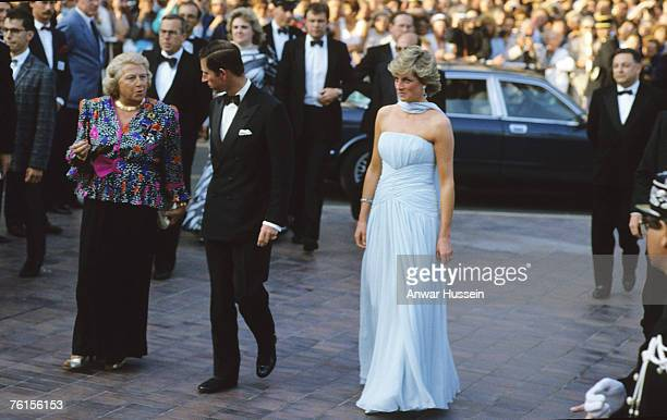 Princess Diana Princess of Wales and Prince Charles Prince of Wales a Cannes film festival Diana wore a pale blue chiffon dress and stole at the...