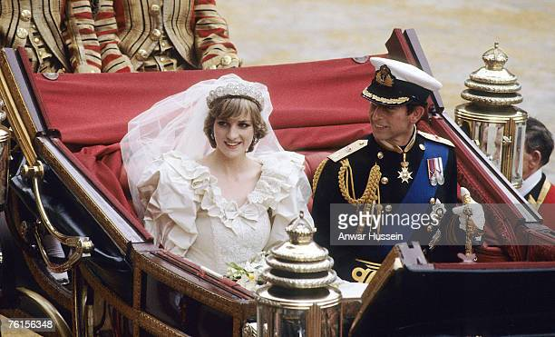 Diana Princess of Wales and Prince Charles ride in a carriage after their wedding at St Paul's Cathedral July 29 1981 in London England
