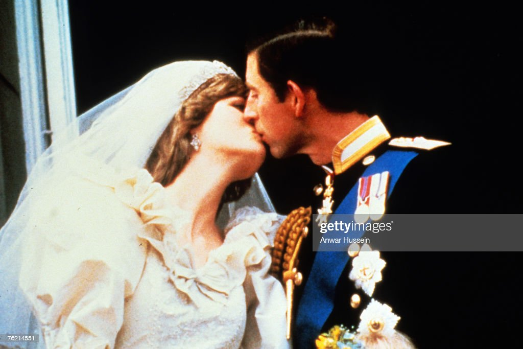 Prince Charles Prince of Wales and Princess Diana Princess of Wales kiss on the balcony of Buckingham Palace following their wedding on July 29 1981...