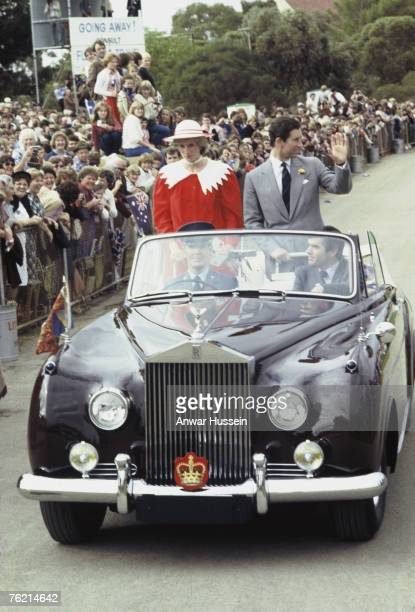 June1983 photo of Princess Diana Princess of Wales and Prince Charles Prince of Wales waving to crowds from an open car during their visit to...
