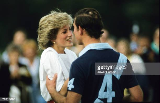 Prince Charles and Princess Diana kiss during a polo match at Cirencester Park Enlgand in July 1985