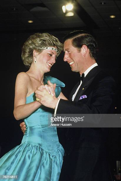 A 1985 photo of Princess Diana Princess of Wales in a David Emanuel dress and Prince Charles Prince of Wales dancing in Melbourne British designer...