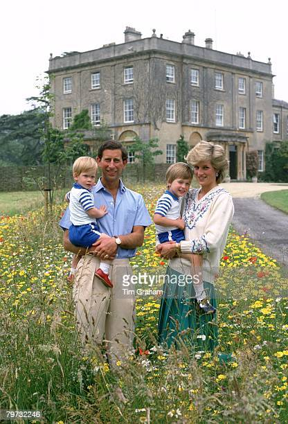 Prince Charles Prince of Wales and Diana Princess of Wales with their sons Prince William Prince Harry in the wild flower meadow at Highgrove