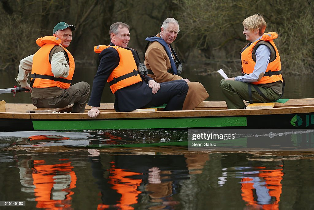 Prince Charles, Prince of Wales and his personal secretary, Jamie Bowden (2nd from L), ride a boat while touring the Kovilj-Petrovaradin marshes on March 17, 2016 near Kovilj, Serbia. The Prince and Duchess are visiting Croatia, Serbia, Montenegro and Kosovo.
