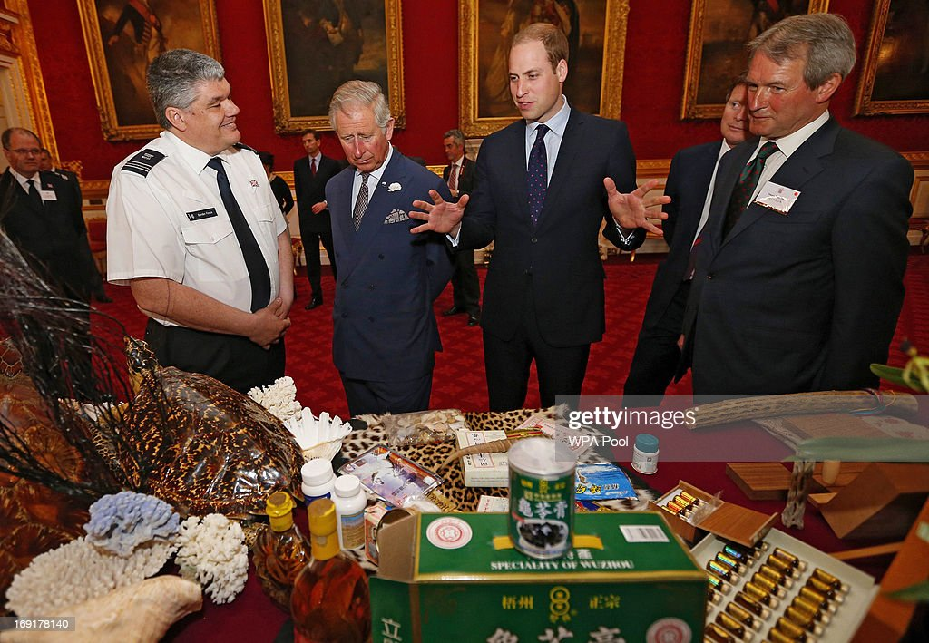 Prince Charles, Prince of Wales (C) and his son Prince William, Duke of Cambridge (3R) are shown items made from endangered animals, which had been confiscated by customs officers, during a conference on the illegal wildlife trade at Clarence House on May 21, 2013 in London, England. The princes lent their support to efforts to eradicate the trade in items made from highly endangered animals.