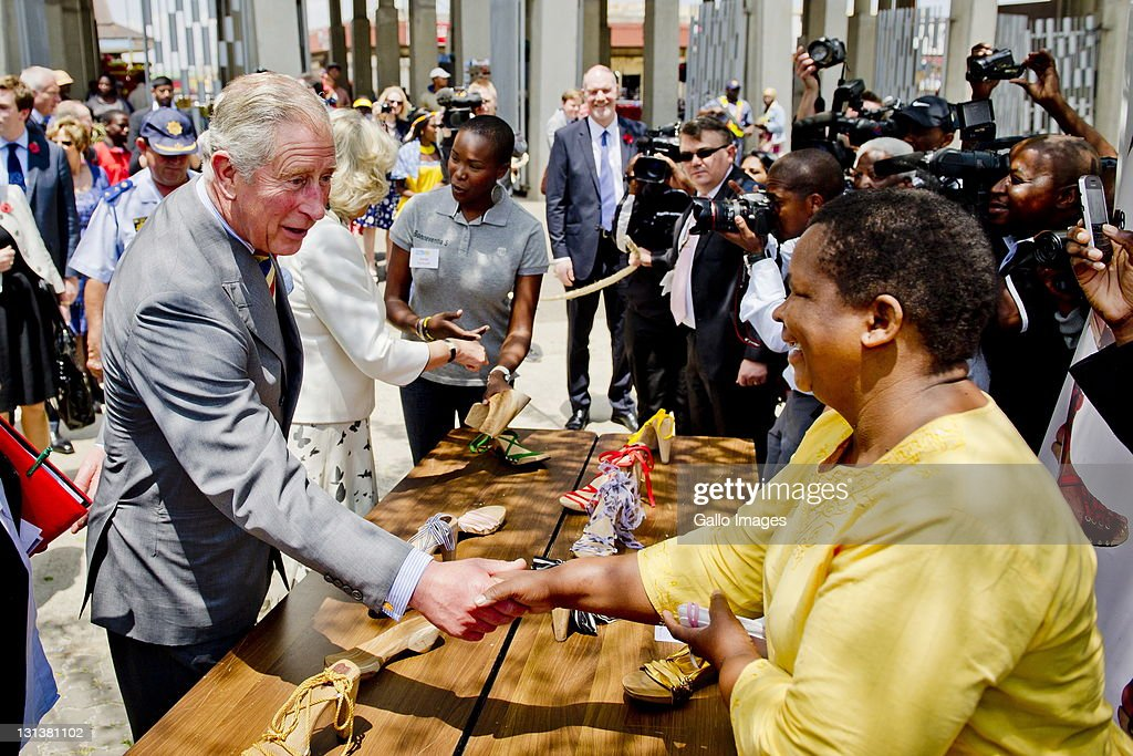 <a gi-track='captionPersonalityLinkClicked' href=/galleries/search?phrase=Prince+Charles&family=editorial&specificpeople=160180 ng-click='$event.stopPropagation()'>Prince Charles</a>, Prince of Wales and his wife <a gi-track='captionPersonalityLinkClicked' href=/galleries/search?phrase=Camilla+-+Duchesse+de+Cornouailles&family=editorial&specificpeople=158157 ng-click='$event.stopPropagation()'>Camilla</a>, Duchess of Cornwall during a visit to a township on November 3, 2011 in Soweto, South Africa. The Prince and Duchess are visiting South Africa as part of the Commonwealth tour.