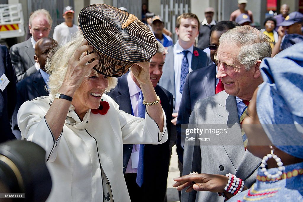Prince Charles, Prince of Wales and his wife <a gi-track='captionPersonalityLinkClicked' href=/galleries/search?phrase=Camilla+-+Hertogin+van+Cornwall&family=editorial&specificpeople=158157 ng-click='$event.stopPropagation()'>Camilla</a>, Duchess of Cornwall during a visit to a township on November 3, 2011 in Soweto, South Africa. The Prince and Duchess are visiting South Africa as part of the Commonwealth tour.