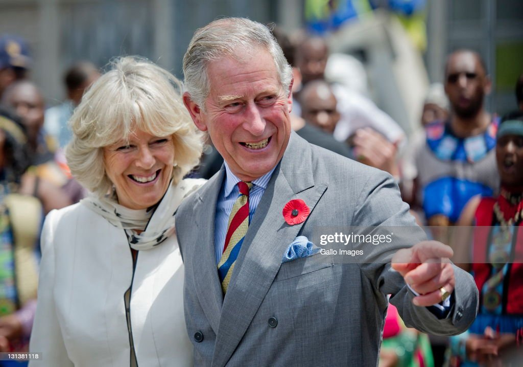 Prince Charles, Prince of Wales and his wife <a gi-track='captionPersonalityLinkClicked' href=/galleries/search?phrase=Camilla+-+Duchessa+di+Cornovaglia&family=editorial&specificpeople=158157 ng-click='$event.stopPropagation()'>Camilla</a>, Duchess of Cornwall during a visit to a township on November 3, 2011 in Soweto, South Africa. The Prince and Duchess are visiting South Africa as part of the Commonwealth tour.