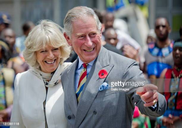 Prince Charles Prince of Wales and his wife Camilla Duchess of Cornwall during a visit to a township on November 3 2011 in Soweto South Africa The...