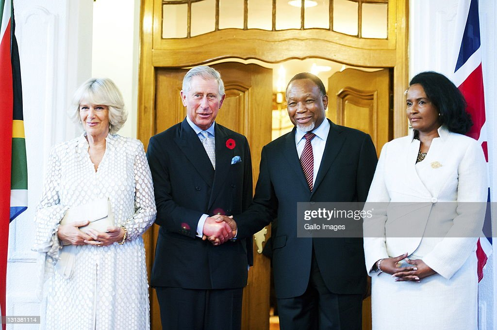 Prince Charles, Prince of Wales (2nd L) and his wife Camilla, Duchess of Cornwall (L) at Oliver Tambo House on November 3, 2011 in Pretoria, South Africa where they met Deputy President <a gi-track='captionPersonalityLinkClicked' href=/galleries/search?phrase=Kgalema+Motlanthe&family=editorial&specificpeople=4754051 ng-click='$event.stopPropagation()'>Kgalema Motlanthe</a> and his wife Mapula Motlanthe. The Prince and Duchess are visiting South Africa as part of the Commonwealth tour.