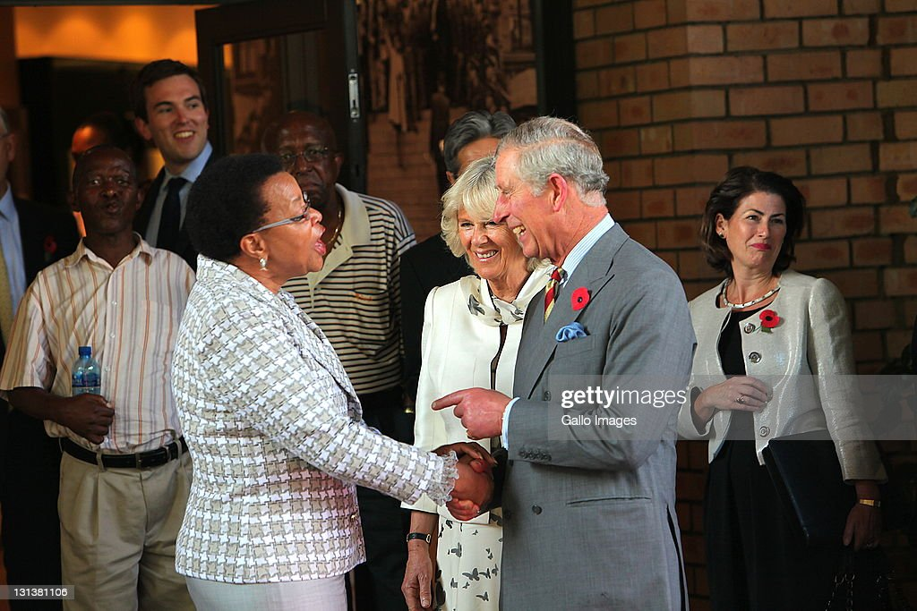 Prince Charles, Prince of Wales and his wife <a gi-track='captionPersonalityLinkClicked' href=/galleries/search?phrase=Camilla+-+Hertogin+van+Cornwall&family=editorial&specificpeople=158157 ng-click='$event.stopPropagation()'>Camilla</a>, Duchess of Cornwall with former President Nelson Mandela's wife Graca Machel (L) during a visit to the Nelson Mandela Foundation on November 3, 2011 in Johannesburg, South Africa. The Prince and Duchess are visiting South Africa as part of the Commonwealth tour.