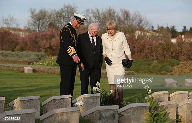Prince Charles Prince of Wales and Irish President Michael D Higgins and his wife Sabina during a visit to V Beach cemetery close to the area where...
