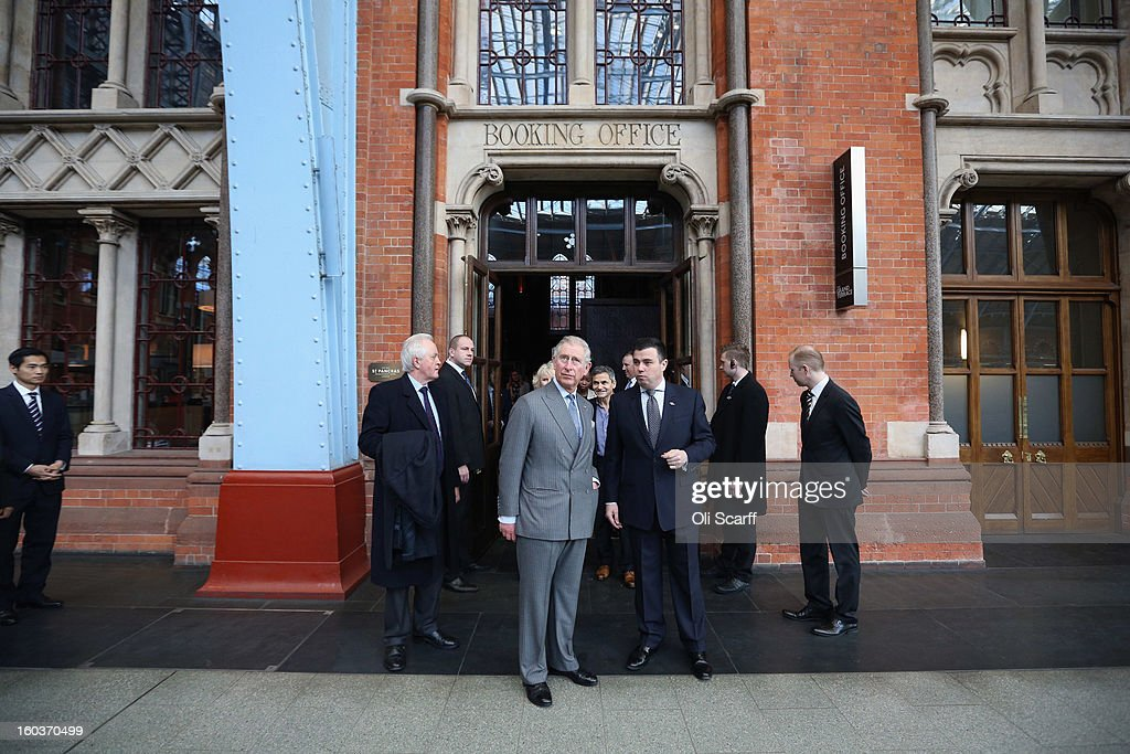 Prince Charles, Prince of Wales (centre L) and Kevin Kelly (centre R), General Manager of St Pancras Renaissance London Hotel admire the architecture of St Pancras International Station during a visit to St Pancras Renaissance London Hotel, adjacent to St Pancras International Station, on January 30, 2013 in London, England. The Prince of Wales and The Duchess of Cornwall are marking the 150th anniversary of London Underground to emphasise the importance of engineering and infrastructure development in the UK.