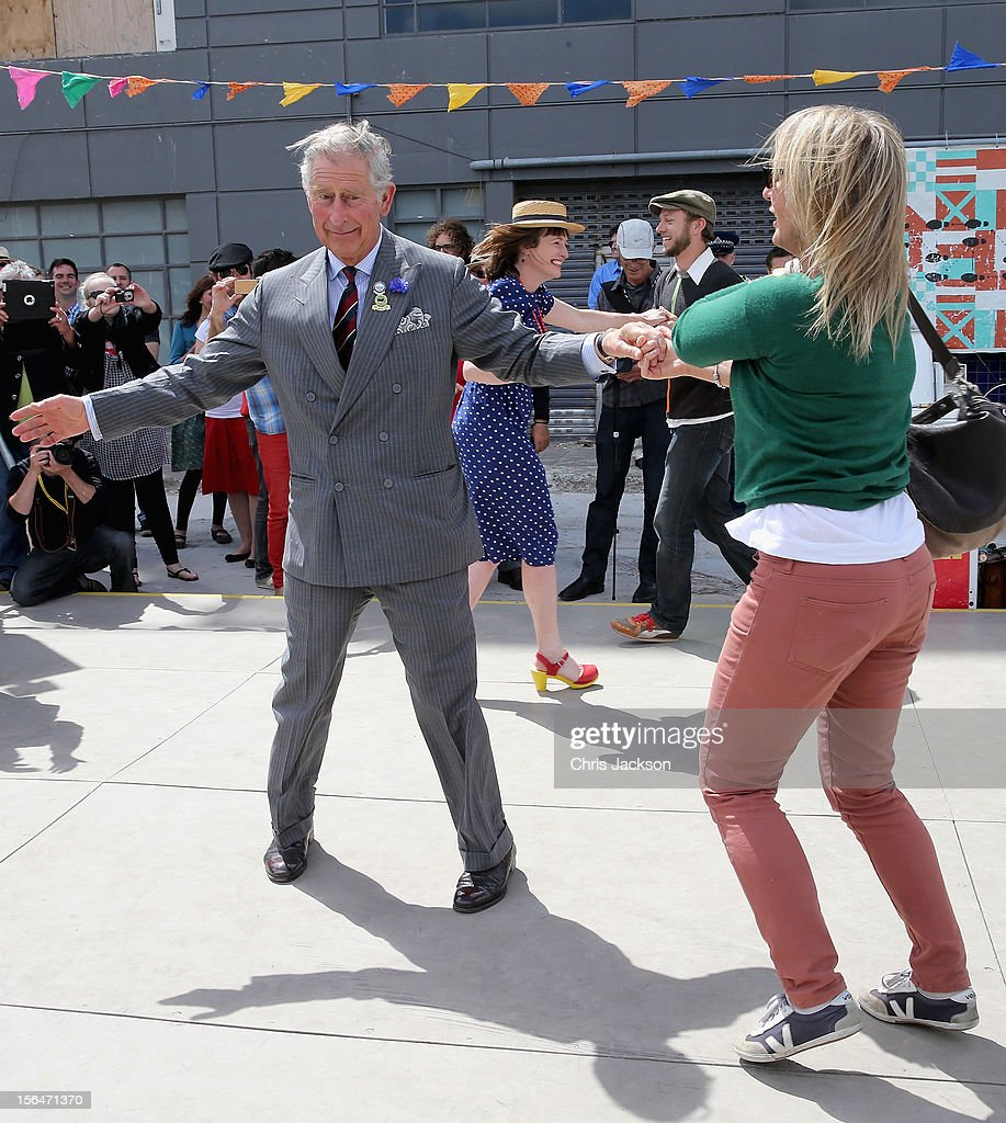 Prince Charles, Prince of Wales and Lisa Shannon (R) dance at the Dance-O-Mat during a visit to Christchurch on November 16, 2012 in Feilding, New Zealand. The Dance-O-Mat was set up to give people the opportunity to keep dancing after many of the venues were destroyed by the earthquake of 2010. The Royal couple are in New Zealand on the last leg of a Diamond Jubilee that takes in Papua New Guinea, Australia and New Zealand.