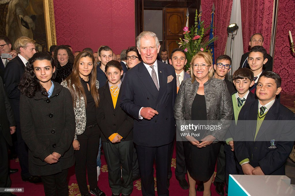 Prince Charles, Prince of Wales and Marie-Louise Coleiro Preca, The President of Malta pose with children involved in The Prince's Trust Internaitonal at a special reception at the Palace of the Grandmaster on November 26, 2015 in Valletta, Malta. The Prince of Wales launched the Prince's Trust International, a global extension of the United Kingdom's leading youth charity, The Prince's Trust.