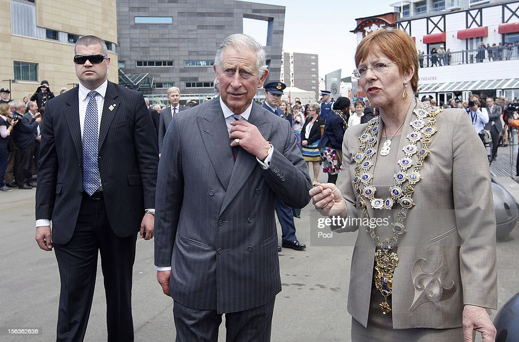 Prince Charles, Prince of Wales and Mayor of Wellington Celia Wade-Brown walk on the wharf waterfront on November 14, 2012 in Wellington, New Zealand. The Royal couple are in New Zealand on the last leg of a Diamond Jubilee that takes in Papua New Guinea, Australia and New Zealand.