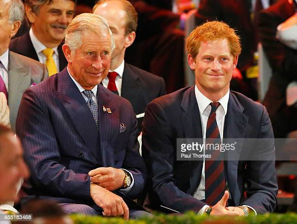 Prince Charles Prince of Wales and Prince Harry attend the opening ceremony for the Invictus Games presented by Jaguar Land Rover at Queen Elizabeth...
