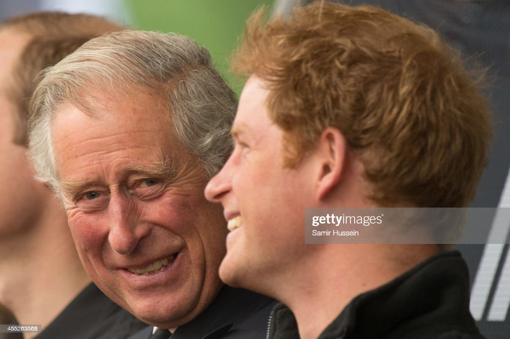 Prince Charles, Prince of Wales and Prince Harry watch the athletics at Lee Valley Track during the Invictus Games on September 11, 2014 in London, England.