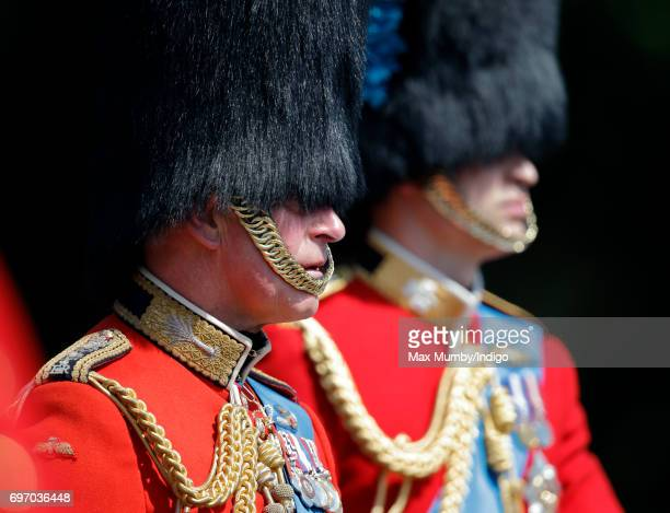 Prince Charles Prince of Wales and Prince William Duke of Cambridge leave Buckingham Palace on horseback during the annual Trooping the Colour Parade...
